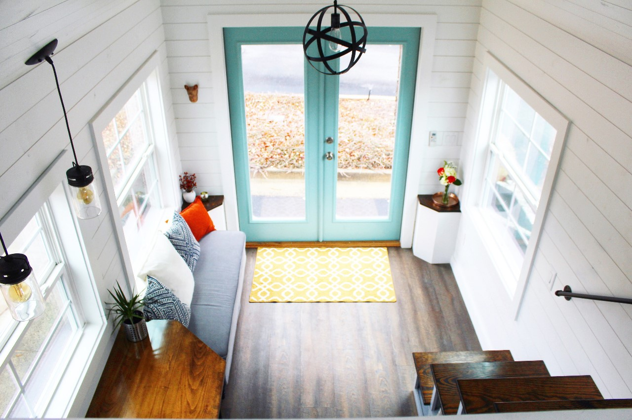 The Sprout from Mustard Seed Tiny Homes - living room view from loft