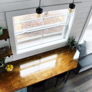 The Sprout from Mustard Seed Tiny Homes - kitchen view from loft